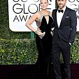 Wearing a custom Atelier Versace dress, Christian Louboutin shoes, and Lorraine Schwartz jewels to the 2017 Golden Globe Awards.