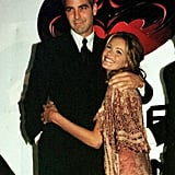 Elle Macpherson got flirty with George Clooney at the Australian premiere of Batman and Robin in June 1997.