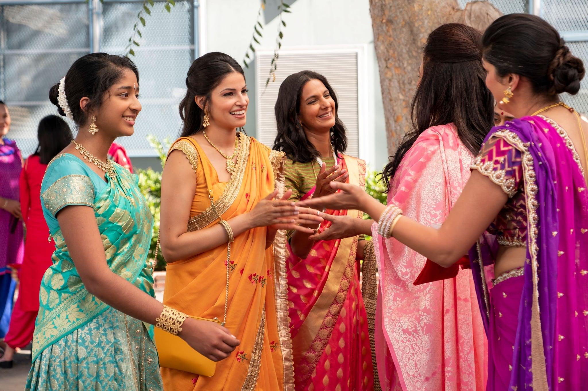NEVER HAVE I EVER, from left: Maitreyi Ramakrishnan, Richa Sukla, Poorna Jagannathan, Alice Amter (back to camera), Sohm Kapila (back to camera), '...gotten drunk with the popular kids', (Season 1, ep. 103, aired April 27, 2020). photo: Lara Solanki /  Netflix / Courtesy Everett Collection