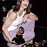 Madonna posed with her many awards in the Grammys press room back in 1999.