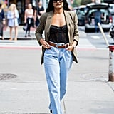 Masculine meets feminine when you pair your slouchy borrowed-from-the-boys jeans with a fitted bustier and tailored blazer.