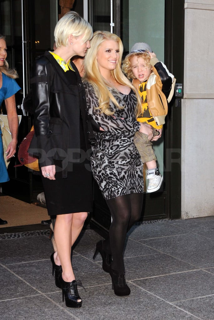 Jessica and Ashlee Simpson brought little man Bronx out in NYC this afternoon. Jessica's been in the Big Apple all week after spending Thanksgiving with fiancé Eric Johnson and his family in Boston. The couple checked out Lady Gaga's Workshop at Barneys and also shared a date night when Jessica wasn't busy working. She was up early yesterday for a business meeting following a fun night out at the Footwear News Achievement Awards. Jessica wore a tight red dress, which showed off her growing baby bump, on the red carpet alongside Eric Tuesday. She presented the brand of the year statue to her business partner Vince Camuto. Rachel Zoe was also honored at the event and shared a funny story about being salesperson of the year at Nine West when she was younger.