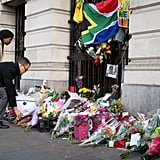 A couple added flowers to the memorial in London.