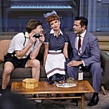 Kelly Ripa wears a spot-on costume as Lucille Ball, alongside Mark Consuelos as Ricky Ricardo and Ryan Seacrest as Little Ricky from the '50s classic I Love Lucy.