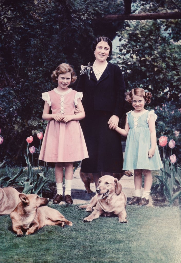 A 10-year-old Elizabeth with little sister Margaret; their mother, Queen Elizabeth; and the family Corgis in 1936, the year her father became king.