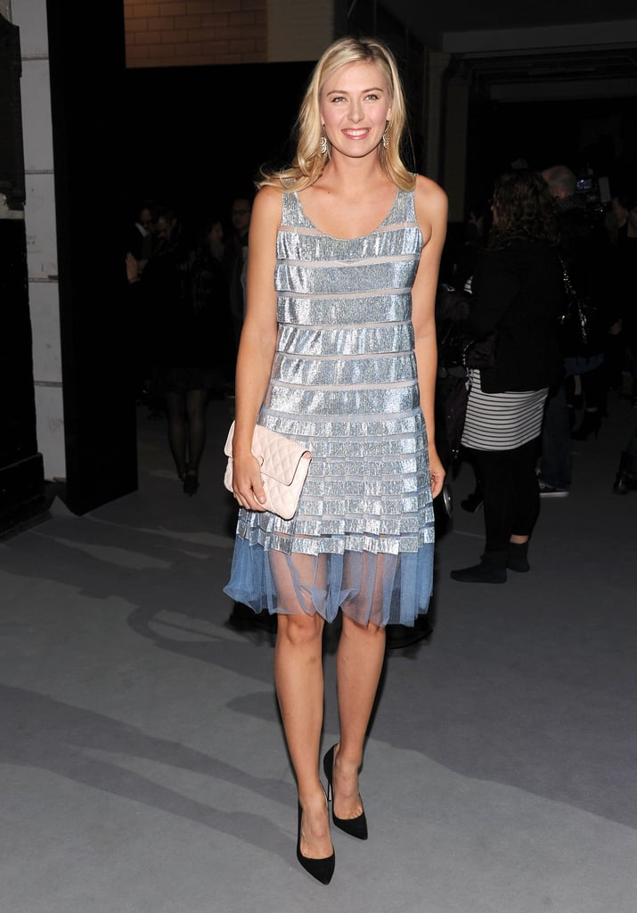 Maria Sharapova opted for a striped shimmering sheath, complete with a pretty sheer hemline at Marc Jacobs.