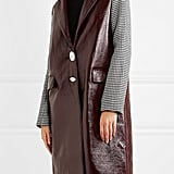 Trouble committing to one trend at once? Not anymore. This Wanda Nylon Houndstooth Tweed-Paneled Textured-Vinyl Coat ($1,210) lets you mix two simultaneously.
