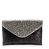 Even if you're wearing a t shirt and jeans, this glittered J.Crew Invitation Clutch ($98) will ensure that you look ready to party.