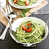 Sometimes, simple is better. Highlight the flavor of zucchini with a light olive oil sauce, and garnish with fresh basil and tomatoes.