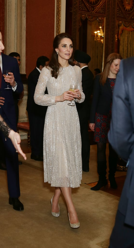 "While you were head's down in the Oscars — and we don't blame you — you might have missed the Duchess of Cambridge's outing Monday. The duchess stepped out for a reception in London to mark the launch of the UK-India Year of Culture.   Ever the fashion diplomat, Kate paid homage to both nations, simply with what she wore. She slipped into a shimmering lace dress by British designer Erdem and added earrings by Indian jeweller Anita Dongre, though our eyes were glued especially to her coordinating pumps, a princess-worthy pair finished in all-over sparkle. Like most things Kate wears, the look managed to be both decidedly sophisticated and just a touch glam. In fact, the look will have you thinking, ""It's just so Kate."" Read on to see her latest look in full."