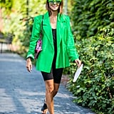 Slip into a pair of slides and add a blazer to make biker shorts more sophisticated, less sporty.