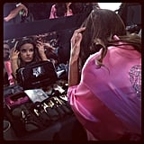 Alessandra Ambrosio checked her makeup in the mirror.  Source: Instagram user popsugar