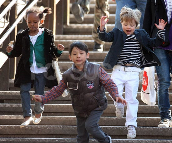 Slide Photo of Zahara, Pax and Shiloh Jolie-Pitt Jumping Down the Stairs in Italy