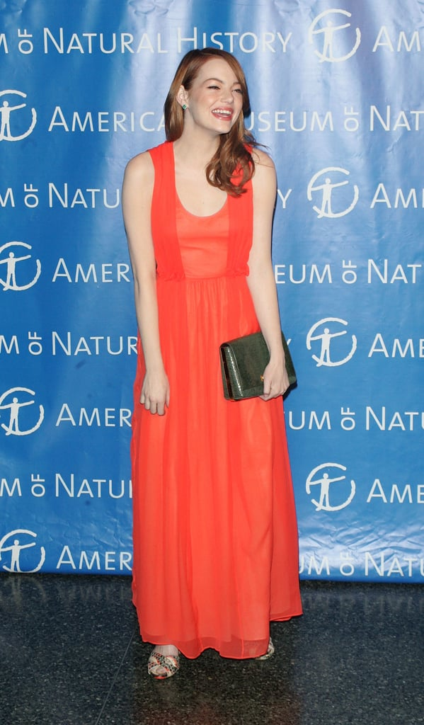 Emma Stone's bright smile matched her vibrant coral gown at an NYC event in November 2011.