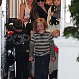 Gwen Stefani laughs as Angelina Jolie and her kids leave her home.