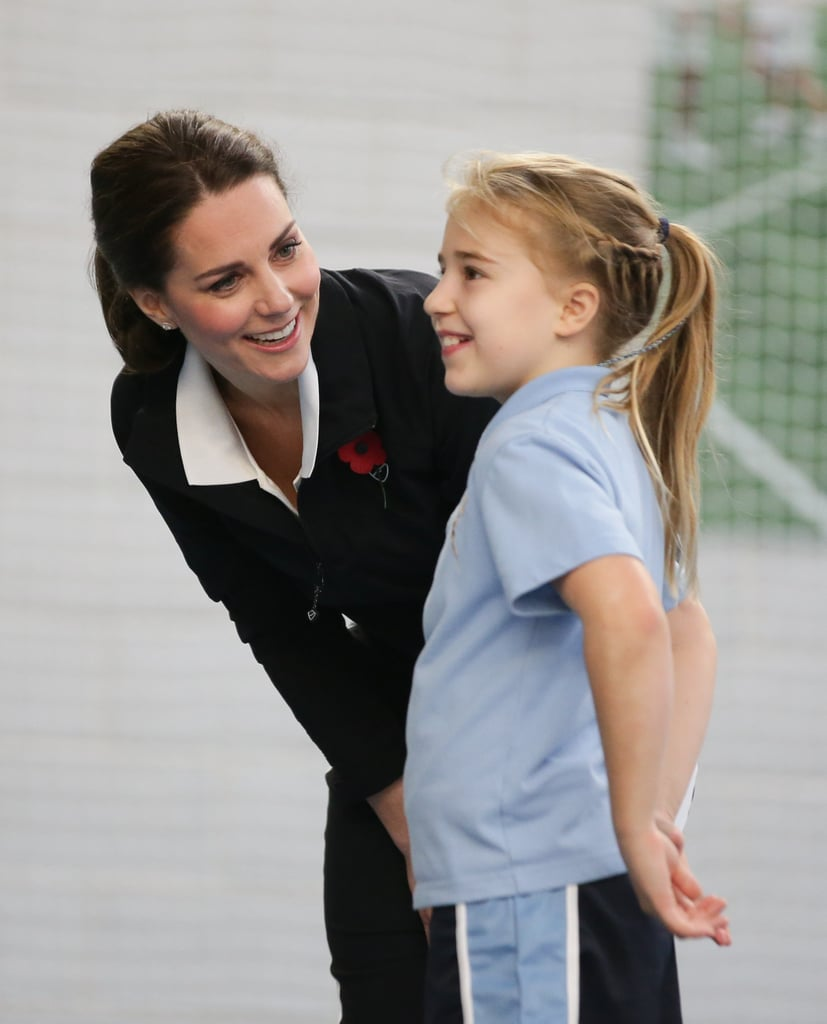 Kate talked to a little girl while taking part in a Tennis for Kids session at the Lawn Tennis Association in London in October 2017.