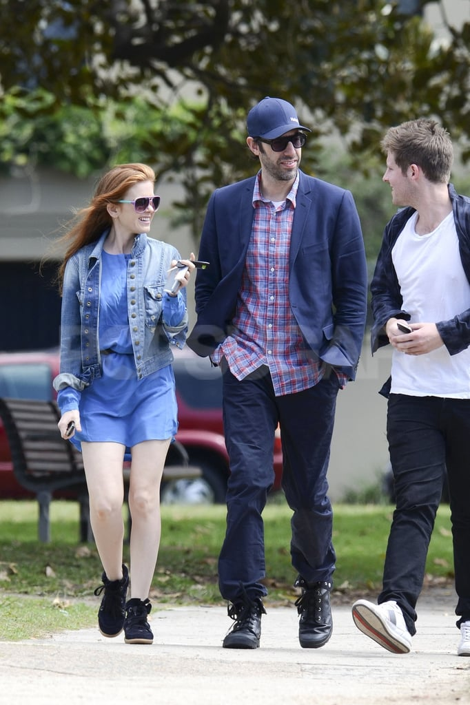 Isla Fisher and Sacha Baron Cohen chatted with a friend in Australia.