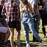 Rumored girlfriend to Prince Harry Cressida Bonas showed off a Glastonbury look we can't quite picture Kate Middleton in: cuffed overalls, white sneakers, and neon green shades.