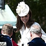 Kate greeted Prince Charles as she entered a shared carriage during the 2012 Order of the Garter events.