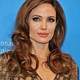 Angelina Jolie in a gold gown at the premiere of In the Land of Blood and Honey in Berlin.