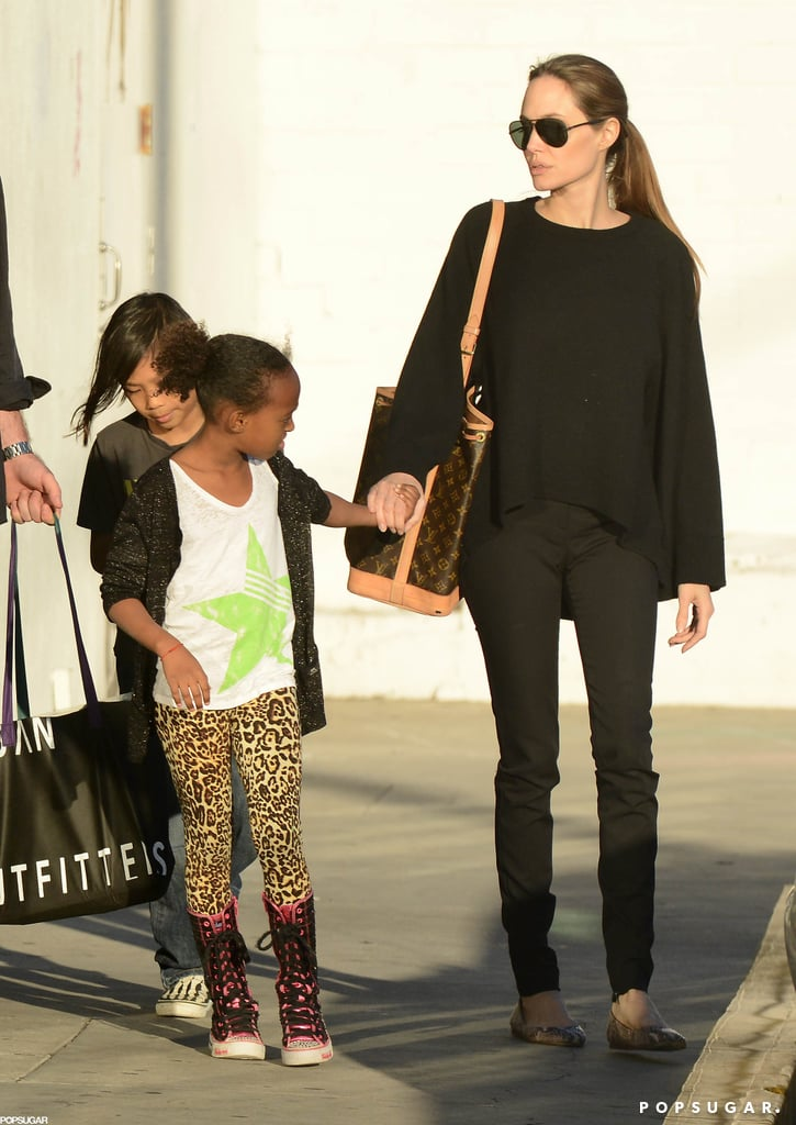 Angelina Jolie held hands with Zahara and Pax for an LA shopping trip.