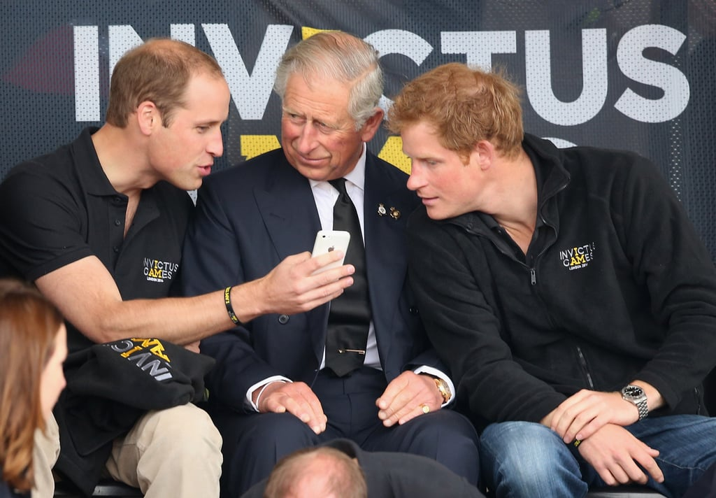 William showed Charles and Harry something on his phone on Thursday.