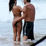Javier Bardem cuddled up to Penélope Cruz during a vacation in Brazil in January 2008.