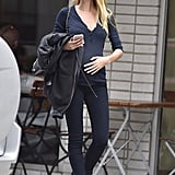 Candice Cradled Her Baby Bump in a Navy and Black Look