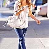 Keeping it casual in a simple white tee, skinny jeans, heels, and a Balenciaga bag in 2009.