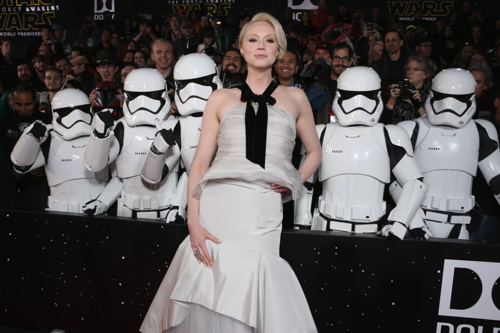 """There were was so much star power at the Star Wars: The Force Awakens premiere in LA on Monday evening. Daisy Ridley stunned in a white polka-dot dress, while Gwendoline Christie looked gorgeous in a silver gown. Along with them were cast members John Boyega, Lupita Nyong'o, and Peter Mayhew, who all showed up for the movie's big night and were joined by BB-8, C-3PO, and a gang of stormtroopers.  The long-awaited sequel to Star Wars comes out on Dec. 18 and we cannot wait! While making his rounds for press, Harrison Ford hinted at Han and Leia's """"interesting relationship,"""" and Lupita, who plays Maz Kanata, told us exclusively about the time she got to bring her best friend to the Star Wars set. Watch the Star Wars trailer now, and then check out the six surprising things you won't see in the film."""