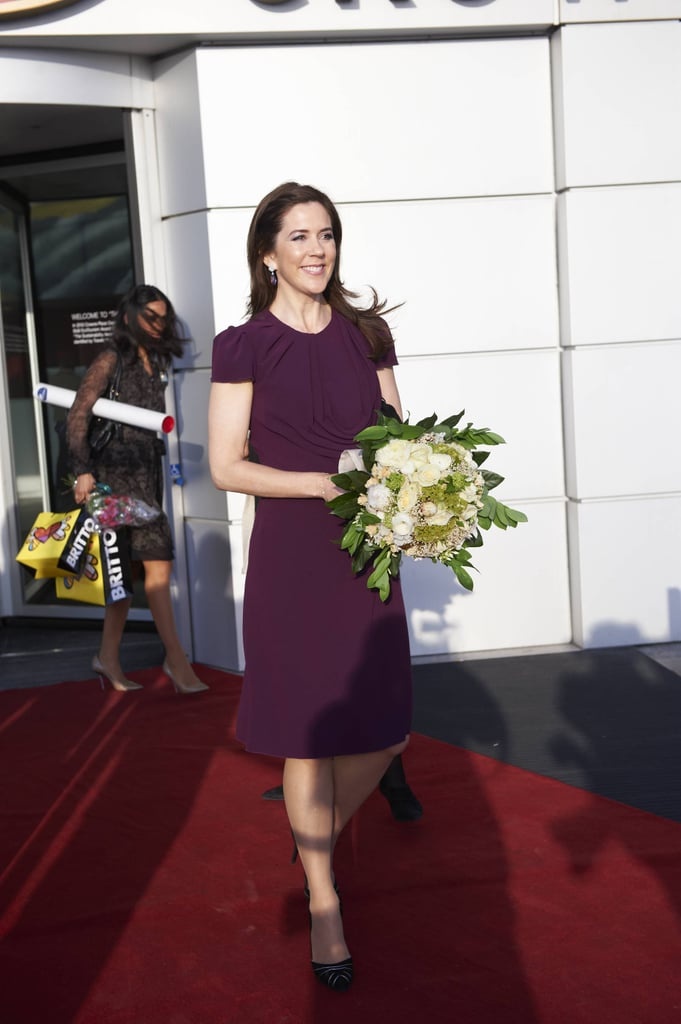 Sometimes all you need is a fitted frock. Love this merlot hue on her.