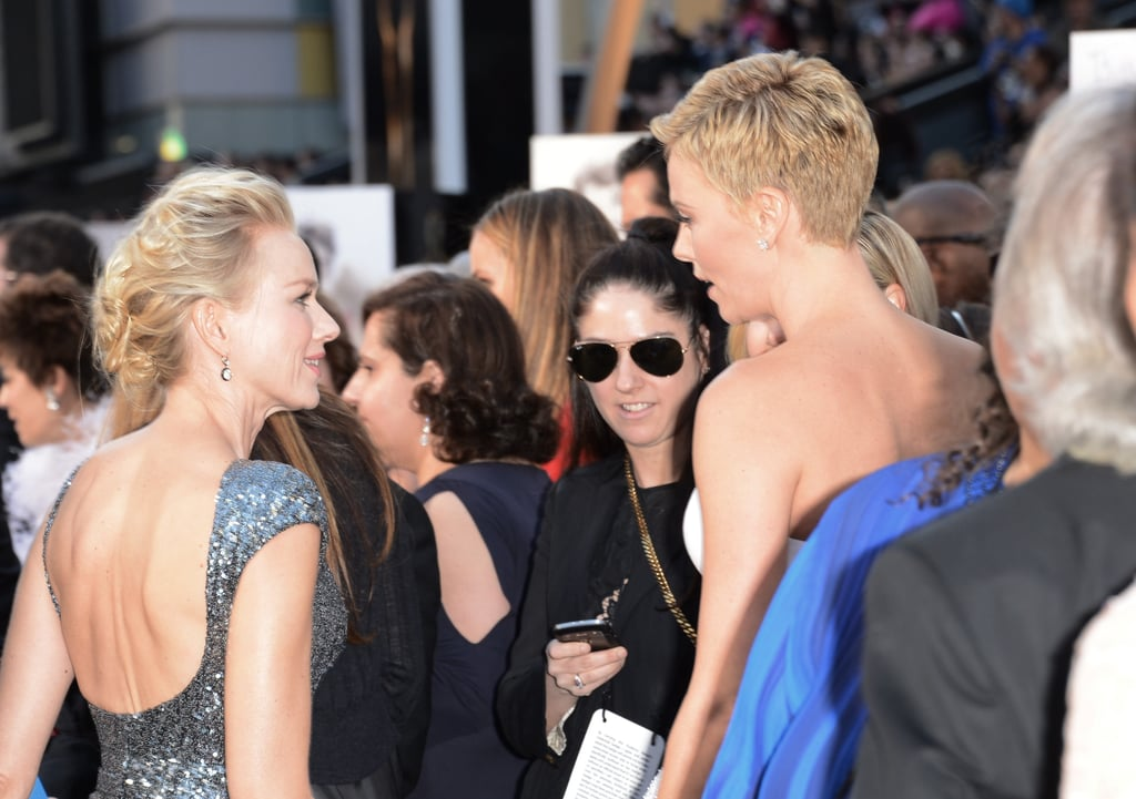 Naomi Watts and Charlize Theron caught up on the carpet.