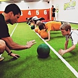 This pic was shared on Sam's company's Instagram account and shows Sam hard at work building kids' fitness.