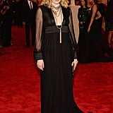 Greta Gerwig's black Saint Laurent gown featured a sexy plunging neckline and sheer sleeves. She finished with Fred Leighton gold jewels and Christian Louboutin Pigalle pumps.