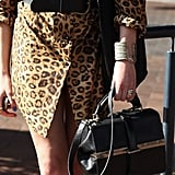 We want that structured black tote for our own animal-print styling aspirations.