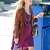 Reese Witherspoon offset her pretty eggplant-colored dress with layers of colorful beads.