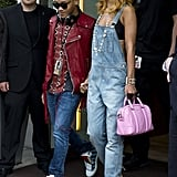 Rihanna rocked denim overalls and colorful lace-up sandals by Sophia Webster while cruising around London in June 2013.