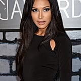 "Makeup artist Jo Baker was inspired by the '70s disco era when creating Naya Rivera's VMAs beauty look. To achieve this feel, Baker used the NP Set Day to Night Palette ($24) over Naya's lids. She then went over the top with NP Set All That Glitters Gel Duo in Sao Paulo ($10) for depth and shimmer. Black liner and mascara brought it all together.  For the hair, stylist Clyde Haygood created a ""modern-day Cher look"" using Wella Professionals Velvet Amplifier (inquire for price) on damp hair prior to blow-drying, followed by the brand's Ocean Spritz (inquire for price) for added texture once dry."