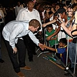 Prince Harry Busts a Move and Tries the Booze in Belize