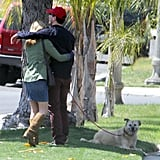 Jon Hamm and Jennifer Westfeldt put their arms around each other in LA.