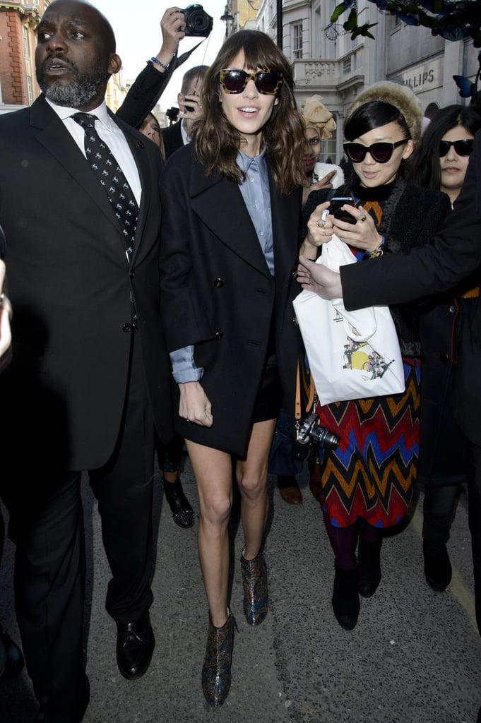 Alexa Chung wore shorts and a black coat to London Fashion Week events in February.