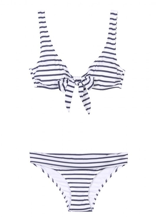 """""""Summer doesn't officially start till I've got the perfect swimsuit. To me, this is it. A classic striped suit with the sweetest bow to finish it off."""" — Hannah Weil, assistant editor  Heidi Klein Stripe Bay Bow Top Bikini ($309)"""