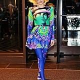 Wearing a vibrant Versace look.
