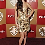 The brunette stunner posed in a decadent guilded Versace minidress for the InStyle and Warner Bros. Golden Globe afterparty in Beverly Hills.