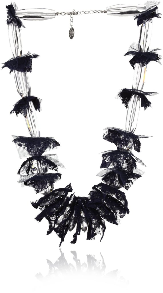 Fun and festive, this statement necklace is a great conversation starter.  Adia by Adia Kibur Lace Layered Lucite Necklace ($70)