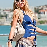 Paris Hilton wore a headband and bracelets with her blue bathing suit at the beach in Australia.