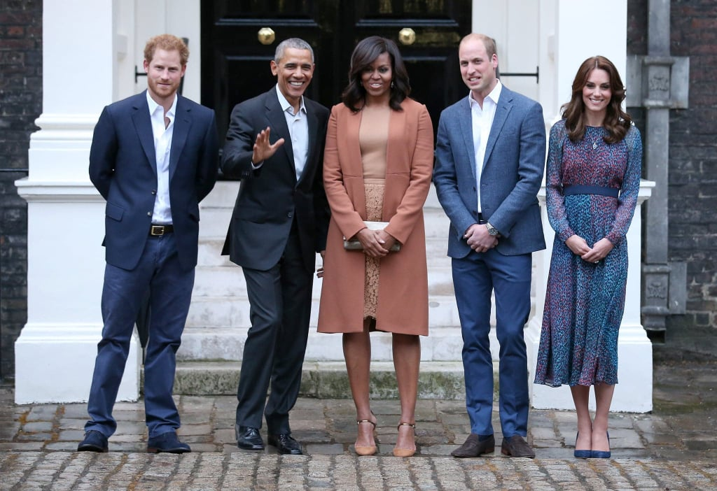 After spending time with the queen, POTUS and FLOTUS braved the rain for a photo op with Prince Harry, Prince William, and Kate Middleton.