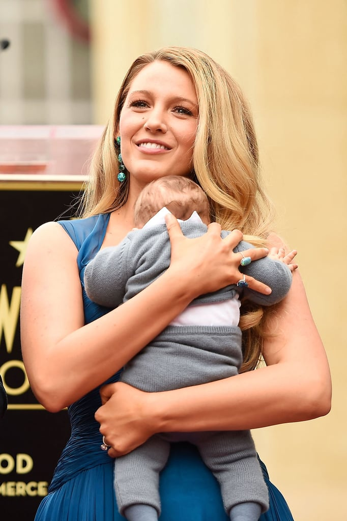 Blake Lively and Ryan Reynolds have always been intensely private when it comes to their two adorable daughters, but the superstar couple made their public debut as a whole family at Ryan's Hollywood Walk of Fame ceremony on Dec. 15. The Deadpool actor's bond with his kids instantly had us swooning, but Blake's sweet moments with 2-year-old James and their newborn — whose name they've yet to make public — really had our hearts melting. Blake held onto their youngest while James stole the show, running around with her dad's microphone and climbing up on the event's platform. Not to mention, she's the spitting image of her doting mom! With those genes, though, we probably should've known that they were going to look that cute.      Related:                                                                                                           Blake Lively Sends Ryan Reynolds a Loving Message After Stepping Out Together With Their Kids