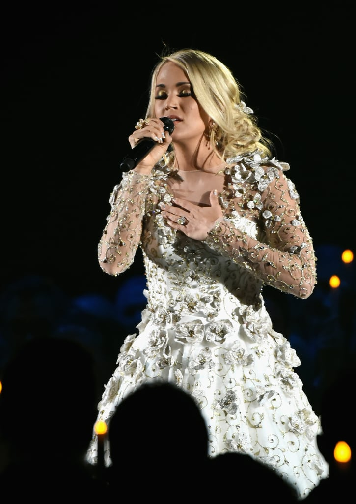Carrie gave an emotional performance honoring the victims of the Las Vegas shooting in an embellished floral dress.
