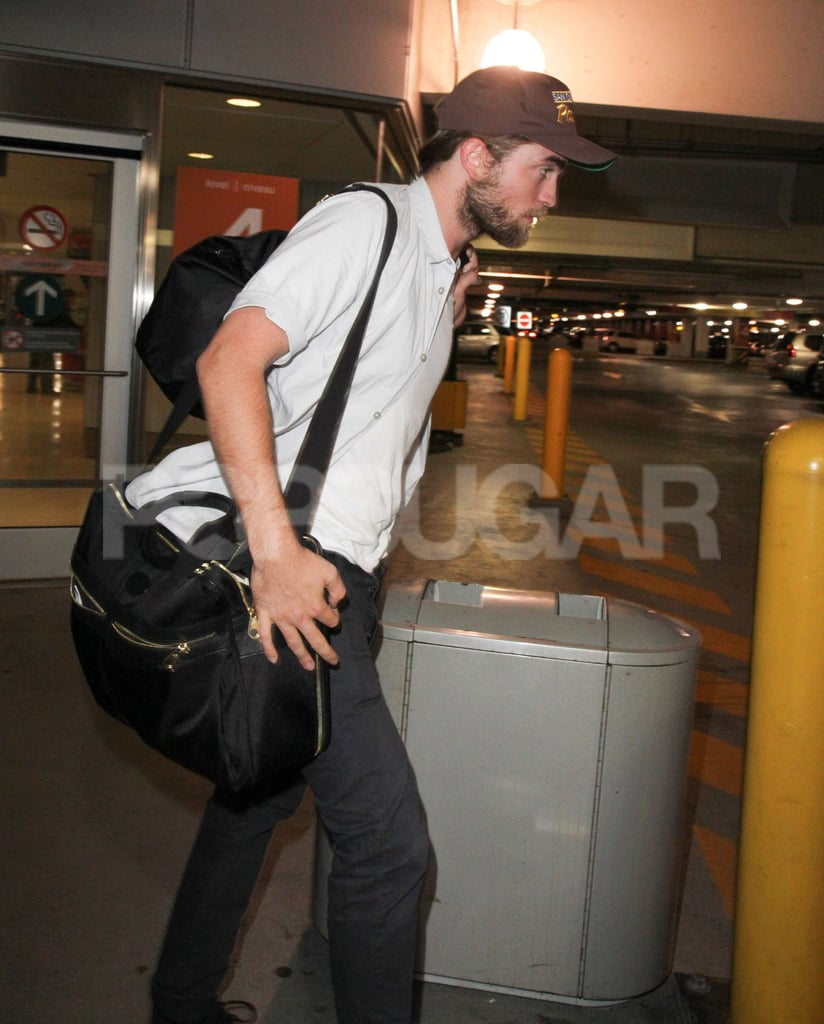 Robert Pattinson kept his shirt open at the Toronto airport.